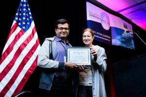 Celia Canfield, Chair of our Board of Directors, presenting the Technology Innovation award to Praveen Madan on behalf of the team behind Giftlit, based in Menlo Park, CA.